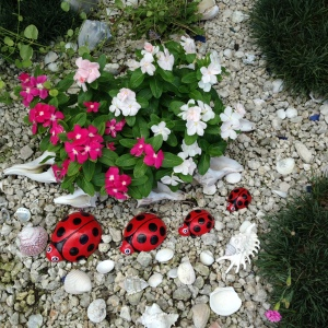 Set of four concrete garden ladybugs