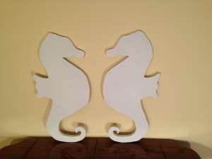Painted, wooden seahorse wall art. Our booth will feature many different shapes, not just seahorses.