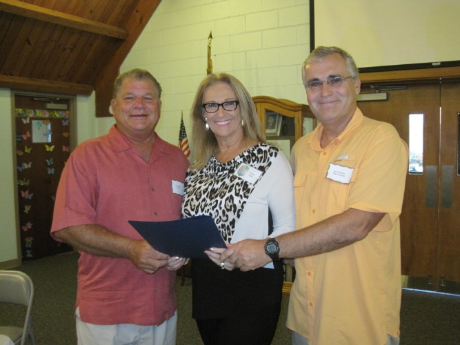 Mayor Holden and Town Manager David Hewitt present President Gail Todd with the proclamation.