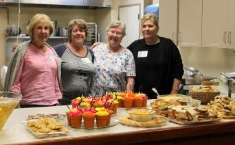 Hostesses Sharon Butler, Frannie Pompeii, Julia Anderson, and Eve Ventners. Not in photo: JoAnn Burke.