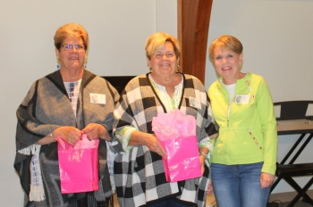 New members Marge Doyle and Judy Bayless are welcomed by Becky Willis.