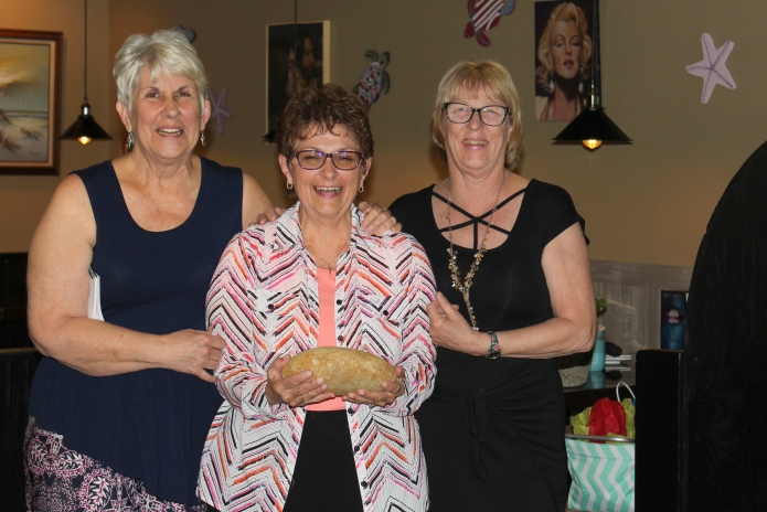 Diana Hadesty (center) is presented Member of the Year Award by Gina Martin and Carol Keane.