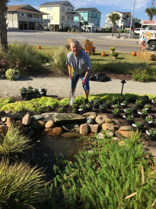 Landscaping Chair Becky Greene gets her gloves dirty planting at Padgett Garden.
