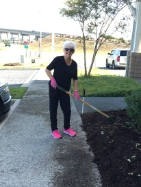 Always fashionable Carolyn Metrakos matched her shoes and garden gloves while prepping the beds.