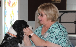 Rescue dog Charli gets a greeting from Vicki Myers.