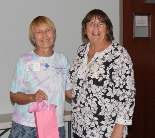 New member Helen is welcomed to the club by President Linda Rast.